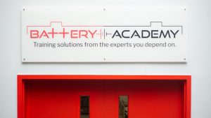 Battery Academy Sign Above Classroom Doors